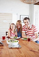 Family sitting at dining table