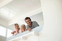 Couple and son lying on bed in loft