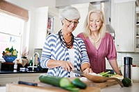 Two senior women cooking together