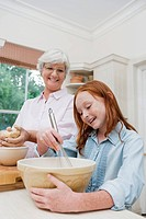 Grandmother and granddaughter 10_12 making cake