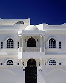 Typical local architecture with white wall reflecting sun, Muscat, Oman