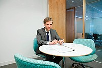 Businessman in office (thumbnail)