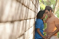Young couple embracing by wall