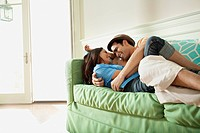 Young couple embracing on sofa