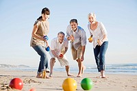 Friends playing boules on beach