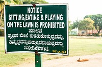 Prohibitive sign and sleeping dog outside a temple in Karnataka