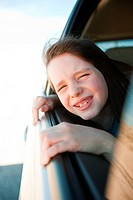 Girl leaning out of car window