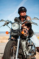Portrait of man parked on motorcycle