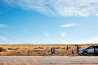 Family with car on desert road