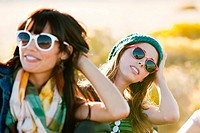 Portrait of two young women wearing sunglasses