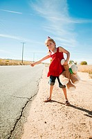 Girl hitchhiking at roadside
