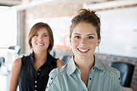 Two young women in office, portrait