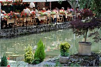 France, Centre, Chartres,cafe terrace by the Eure.