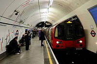 England, London, Embankment. A Northern line tube train arriving at Embankment Underground station