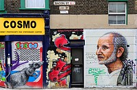 England, London, Tower Hamlets. Graffiti on buildings in Bacon Street, off Brick Lane in London's east end