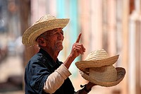 Cuba, Trinidad, old man selling hats