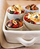 Roasted vegetables in bowl with toasted goat´s cheese