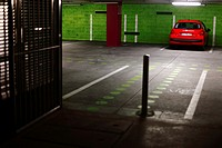 Red car in underground parking lot