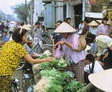 Woman selling lettuce at a street market in Hanoi