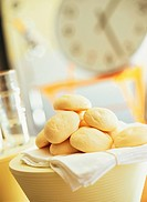 Bread rolls on white cloth in kitchen