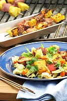 Latin_style cabbage salad with grilled pork and pineapple skewers