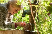 Austria, Salzburg, Flachau, Girl drinking tap water