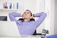 Germany, Bavaria, Munich, Businessman relaxing in office