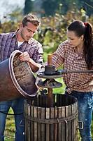 Croatia, Baranja, Young man and woman besides wine press