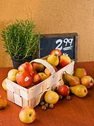 Organic pears and apples, hazelnuts, rosemary and a price sign