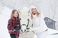 Austria, Salzburg, Hüttau, Mother and daughter with white horse