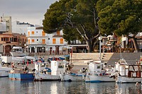 Spain, Balearic Islands, Majorca, Cala Ratjada, View of moored boat with buildings in background