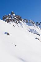 Italy, Trentino_Alto Adige, Alto Adige, Bolzano, Seiser Alm, Mid adult man ski touring on mountain