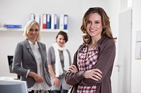 Germany, Bavaria, Munich, Businesswomen in office, smiling, portrait