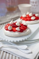 Meringue tarts with strawberries marinated in ginger syrup