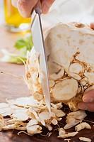 Celariac being peeled