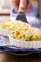 Brussels sprouts and savoy cabbage au gratin with potatoes