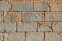 Castle masonry wall carved stone rows pattern ancient texture in Spain