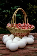 Close_up of eggs near a basket
