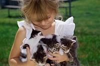 Girl holding kittens
