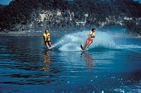 Two young men water skiing