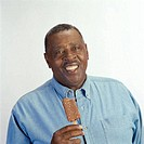 Portrait of a mid adult man holding an ice cream