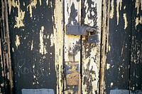 Padlock on a wooden door