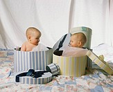 Male twins in gift boxes