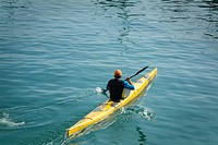 mature man paddling a canoe