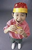Portrait of a boy eating a burger
