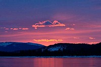 Sunrise over a mountain range, Donner Lake, California, USA