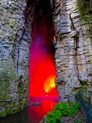Paris, France, Red Light inside Cave in Urban Park, Buttes Chaumont