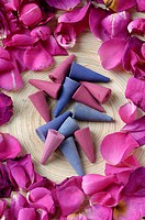 Incenses near rose petals