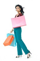 Woman carrying shopping bags and smirking