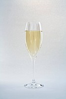 Sparkling wine against grey background, close_up